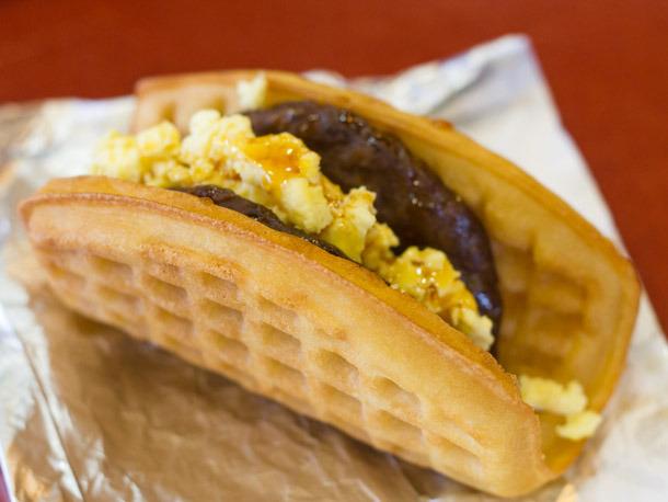 Waffle taco a warm waffle wrapped around a hearty sausage patty or