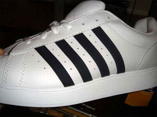 Got my fake Adidas on, whiting out the fourth stripe
