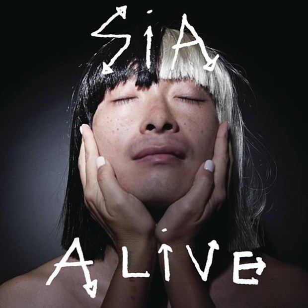 is acting an art Sia is continuing to fly the flag for wigs with her new album artwork the fame-shunning singer has unveiled the striking cover for the upcoming this is acting and given the record a release date .