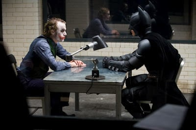 one of the more intense scenes of christopher nolans the dark knight batman approaches joker face to face in the gcpd interrogation room in an attempt to