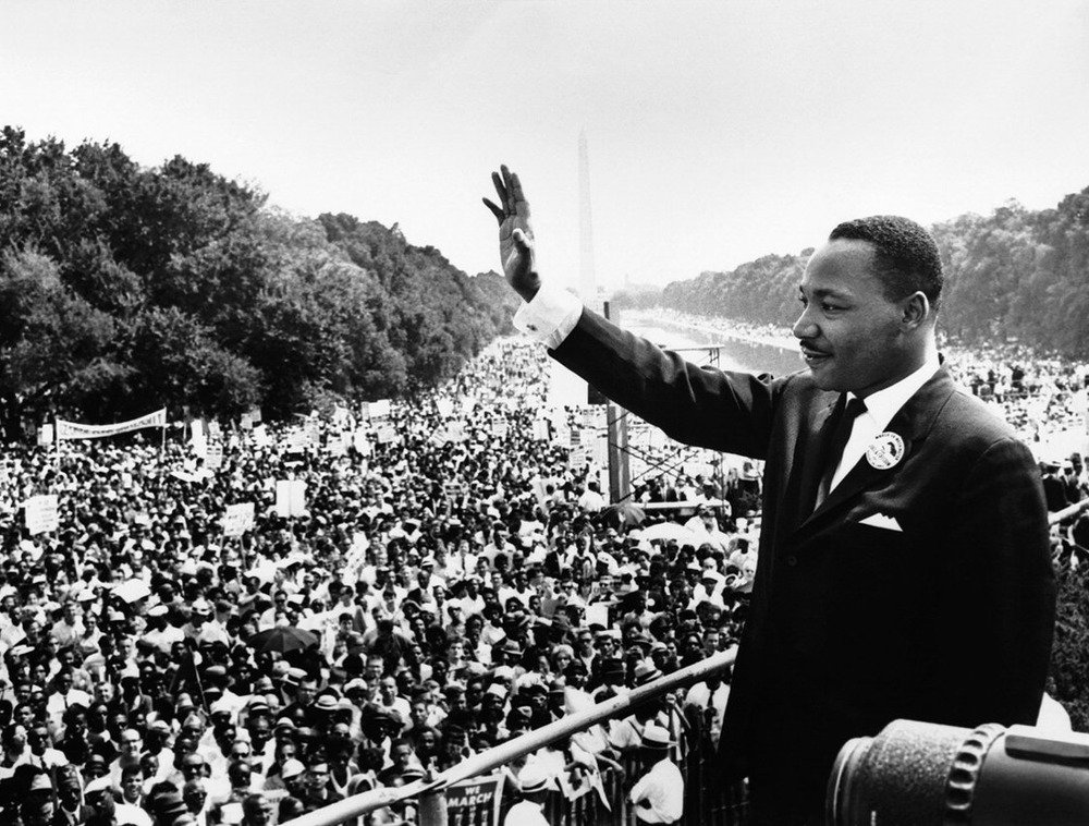 Where is an example of an alliteration in Martin Luther King's speech?